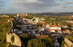 5 Lesser-Known Destinations to Visit in Portugal - via Shermans Travel 31.07.2013 | Rich with history, it seems Portugal itself should be a UNESCO World Heritage Site – we've lost count of how many of its cities and towns have been given the esteemed title. While Lisbon, Porto, and Sintra are all worthy of their own itineraries, if you're looking for something a little bit off the beaten path, here's where you should go to get a unique look at the rest of Portugal... Photo: Obidos, Portugal