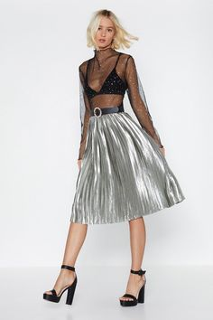 You're most welcome, babe. The We Aim to Pleat Skirt comes in satin and features a high-waisted, A-line, midi silhouette, pleats throughout, and zip closure.