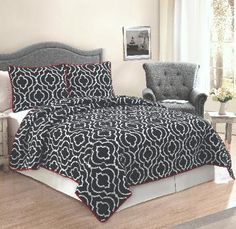 Ogee Bedding  (Black and White Ogee Bedding with a Red   Accent)  Classic black background with a white iron   work print. The back reverses to a contacting   red color to bring a little pop into your room.   This pattern is machine stitched and filled with   80% cotton / 20% polyester fill for a nice   weight and durability.