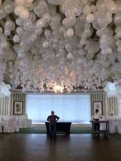 Love this idea: ballons on ceiling.  Add marble inside so ballons hang upside down.  Great idea for venues that do not allow hanging stuff.  #Weddings
