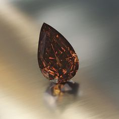 The Golden Maharaja: This large earth-hue diamond is a 65.57-carat gem listed as being Fancy Dark Orange-Brown, having a VS2 clarity.