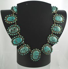 Turquoise necklace - China -  Circa late 1800s-early 1900s    Lovely necklace of matrix turquoise cabochons surrounded by smaller turquoise set in silver.  Marked China on the clasp.