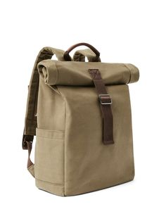 This ain't no roll-top lunch bag. A hybrid of utilitarian street style and casual practicality, this roll-top bag hits the mark with best-of-both-worlds form and function. Crafted of a pliable yet durable cotton canvas with a magnetic strap closure, this
