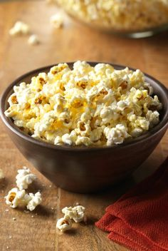 Coconut Oil Popcorn - A delicious and healthy low fat, low calorie snack.  Add some sriracha and you've got my perfect pregnancy snack!