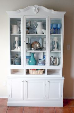 See how Remodelaholic took an ordinary old hutch and added new doors and base, to create a new white hutch.