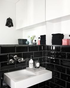 black tile in bathroom for new place? We have white subways with grey grout currently so nice to have a change...although for re-sale, white probably best