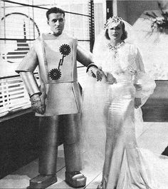 Joan Crawford and unidentified man- Dancing Lady, 1933. Robot costume to be used again in Phantom Empire, 1935, and Captain Video, 1951