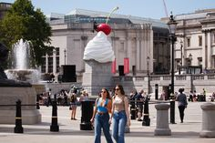 (Jul 30 2020) 'THE END', by British artist Heather Phillipson, sits on the Fourth Plinth in Trafalgar Square in London, England. The installation has seen its debut delayed from March due to the coronavirus pandemic. Its depiction of a cherry-topped swirl of cream, plus a drone and fly, is described by its accompanying explanatory note as a 'monument to hubris and impending collapse' and will remain in place until 2022. (Photo by David Cliff/NurPhoto via Getty Images)