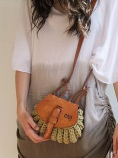 "Thick leather and crochet beige cotton cord bag. Made in Brazil. 6.5"" x 8"""
