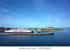 Helsingborg, Sweden - 06 May, 2018: Scandlines ferry HH Ferries cruising out of Helsingor harbor with Kronborg castle on background