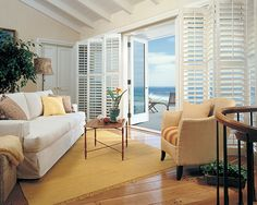 Bi-fold shutters used on a glass door. Austin Window Fashions
