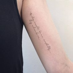"""To die would be and awfully big adventure"" lettering tattoo on the left inner forearm."