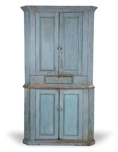 American, Painted corner Cupboard, 19th century, pine two piece cupboard, the upper section with twodoors and a single drawer, the lower section with two doors and resting on a molded base, crusty blue paint, 90 H. x 49.5 W. x 28 D. Requires a 34.5 corner.