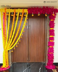 Door decoration with half yellow half red flowers. Diwali Decorations At Home, Wedding Hall Decorations, Festival Decorations, Diy Party Decorations, Flower Decorations, House Warming Ceremony, Thali Decoration Ideas, Housewarming Decorations, Wedding Doors