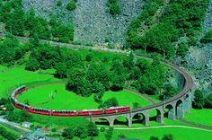 The #BerninaExpress is a train connecting #Chur in #Switzerland to #Poschiavo and #Tirano in #Italy by crossing the #Swiss #Engadin #Alps. For most of its journey, the train also runs along the #WorldHeritageSite known as the #RhaetianRailway in the #Albula / #Bernina #Landscapes.