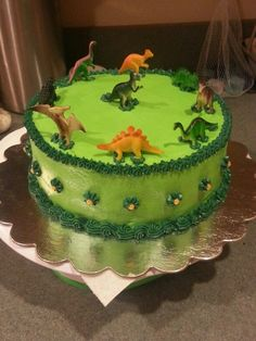 Dinosaur cake, super easy! Fe would love it and she can keep the toys! Win win.