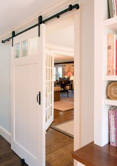 Sliding Door - cheaper than pocket door and takes up little space