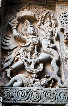 Garuda fighting with snake