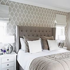 Chose a timeless padded headboard to bring a touch of hotel chic to the bedroom.