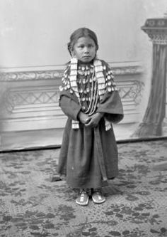 Sunshine, Crow girl, dressed in elk teeth, 1880's
