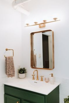 Adore this gold mirror with dark green vanity in this pretty modern bathroom rem. Adore this gold mirror with dark green vanity in this pretty modern bathroom remodel! Such pretty bathroom decor ideas! Family Bathroom, Small Bathroom, Bathroom Ideas, Bathroom Vanities, Bathroom Remodeling, Bathroom Modern, Bathroom Colors, Bathroom Cabinets, Bathroom Designs