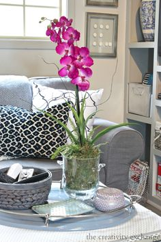 """Quick Trick: Re-Potting Silk Orchids to Look Real. Cyndy says: """"You can do this little trick with any silk stems or plants, not just orchids. Also, you can do multiple plants in larger containers as well."""" Some great tips! Orchid Flower Arrangements, Orchid Centerpieces, Silk Flower Arrangements, Fake Flowers, Silk Flowers, Home Renovation, Silk Orchids, Artificial Orchids, Faux Plants"""