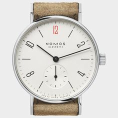 Tangente 33 Doctors Without Borders Watch by NOMOS #watch #wrist #time #clock #minimal #elegant #design #style #black #leather #red