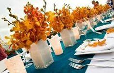 White vases with orange flowers