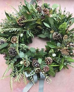 its that time of year again when door wreaths for christmas and autumn start appearing everywhere! I love this one we made for Amy, filled to the brim with seasonal foliage and berries. Christmas Flowers, Natural Christmas, Outdoor Christmas, Christmas Tree Cookies, Noel Christmas, Christmas Crafts, Canada Christmas, Christmas Wreaths For Front Door, Holiday Wreaths
