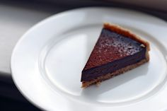 joanne chang's flour bakery double chocolate tart; pate sucree is crunchy, delicate, and punctuated with bits of kosher salt; rich filling is indulgent, not too sweet, and smooth on your tongue.