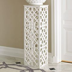As featured in domino's Holiday 2013 issue, this pedestal is made from hand-carved honed white marble from the deserts of India. The fret work pattern is based on traditional Moorish and Indian motifs | domino.com