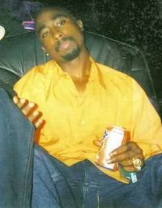 Kicking back with his Sunkist. An ordinary moment captured forever.