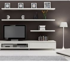 Cropped version of black wall white tv cabinet and floating shelves
