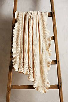 Arlia openweave throw from Anthropologie.