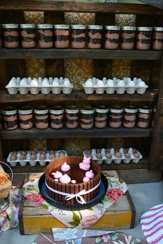 Egg Cake pops and dirt cake dessert displayed on a pallet for barnyard party
