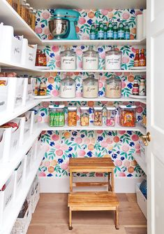 This Pantry Combines Storage and Style with Colorful Wallpaper and Labeled Bins