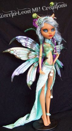 Clawdeen as a sassy butterfly off to the MH Mardi Gras!! by Zerrin-Leon