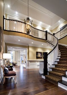 Much better with the stairs facing the side of the foyer instead of the front door. I like the 2 story foyer with a step up or down after the front entry way (one story high to allow for closets) - then step up or down into 2 story foyer. Villa Plan, Style At Home, Beautiful Interiors, Beautiful Homes, Beautiful Stairs, Beautiful Space, Halls, Staircase Design, Curved Staircase