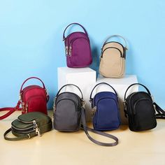 b2a3e1f485c Women Nylon Waterproof Multi- Slot Solid Crossbody Bag Mini Portable Phone  Bag is designer, see other cute bags on NewChic Mobile.