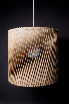 Benjamin Spöth takes leftover birch plywood and crafts lamps from the scraps that were going to be thrown away after he cuts them into thin slices.