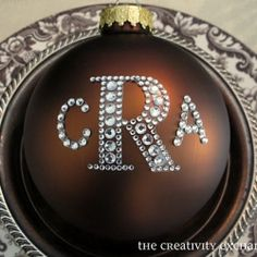 Use rhinestone sticker letters in two different sizes to create monogrammed ornaments