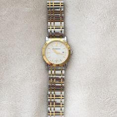 """Authentic Burberry Watch Authentic Burberry watch, silver with gold accents, good conditions, no noticeable scratchesPayPal trades ❤️please use the """"offer"""" button, reasonable offers only Burberry Accessories Watches"""