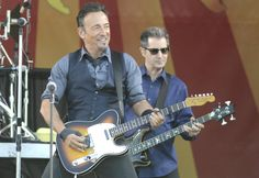 Bruce Springsteen (l.) and Garry Tallent of Bruce Springsteen and the E Street Band perform during Day 6 of the 2014 New Orleans Jazz