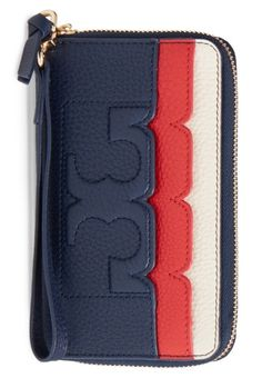 Scalloped edges and Tory Burch logo stitching refine this pebbled-leather zip-around wallet in red, white and blue.