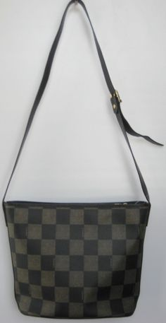 Fendi bag. Multi brown checker print bag with top zip. Has Fendi logo & adjustable long leather strap. $199.50