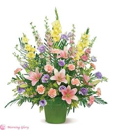 Spring Sonnet - This lovely arrangement of fresh flowers in pale pastel shades of yellow, pink, lavender and green – including blooms such as lilies, lisianthus, carnations and gladioli – creates a touching display that will express your consideration and devotion.