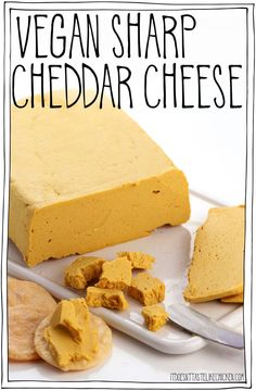 Vegan Sharp Cheddar Cheese! Just 9 easy ingredients and 15 minutes to make. So easy and totally delicious. Perfect for snacking, serving on a vegan cheese board, or adding to sandwiches. #itdoesnttastelikechicken #veganrecipes #vegancheese #dairyfree