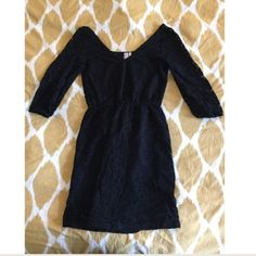 Black lace eyelet dress Black lace eyelet dress with elbow-length sleeves and a low-cut scoop back. See through on the sleeves but has a black lining throughout the rest. In perfect condition, hardly worn. Dresses