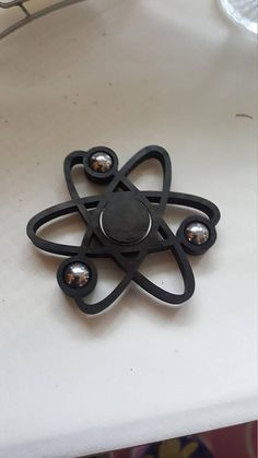 Check out this item in my Etsy shop https://www.etsy.com/no-en/listing/522005145/atomic-spinner-fidget More awesome Fidget Spinners? Yes... www.dizzyspinners.com