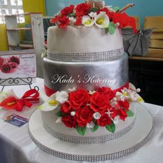 red and white cake, roses, calla lilies, filler flowers, sweet pea